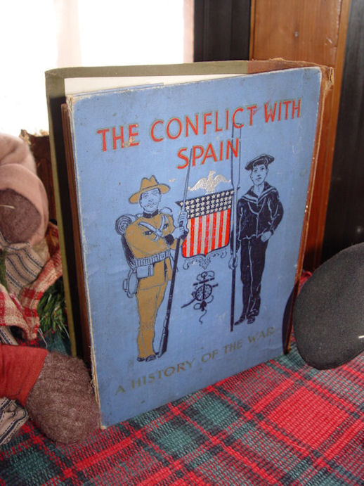 Rare Salesman                                                 Sample of The Conflict                                                 With Spain, A History Of                                                 The War, by Henry F.                                                 Keenan, 1898, illus.